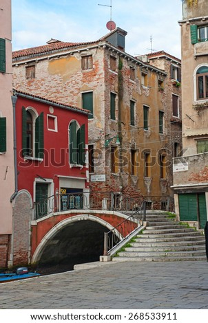VENICE, ITALY-FEBRUARY 5, 2008: typical bridge in Calle dei Morti.. Venice is a great tourists attraction with more than 27 million tourists every year. - stock photo