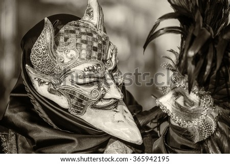 VENICE, ITALY - FEBRUARY 8, 2015: Unidentified masked couple in costume in St. Mark's Square during the Carnival of Venice 2015. The 2015 carnival started on January 31. - stock photo