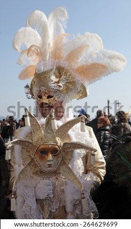 VENICE, ITALY - FEBRUARY 8, 2015: Unidentified masked man in costume on San Marco Square during the Carnival in Venice, Italy. - stock photo