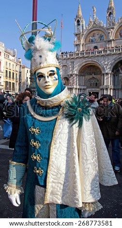 VENICE, ITALY - FEBRUARY 8, 2015: Unidentified masked person in costume on San Marco Square during the Carnival in Venice, Italy. - stock photo