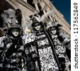 VENICE, ITALY - FEBRUARY 16: Unidentified people in Venetian masks at St. Mark's Square, Carnival of Venice on February 16, 2012. The annual carnival is from February 11 to February 21, 2012. - stock photo