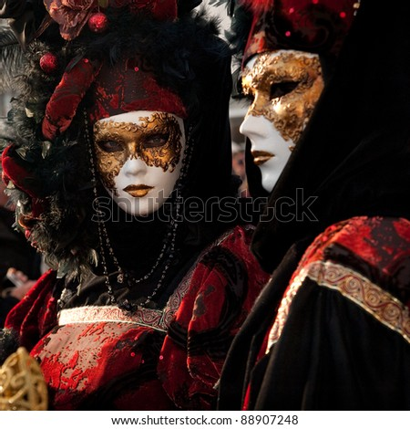 VENICE, ITALY - FEBRUARY 15: Unidentified people in Venetian masks at St. Mark's Square participate in the Carnival of Venice on February 15, 2010. The annual carnival is from February 6 to February 16, 2010. - stock photo