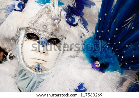 VENICE, ITALY - FEBRUARY 16: Unidentified person in Venetian masks at St. Mark's Square, Carnival of Venice on February 16, 2012. The annual carnival is from February 11 to February 21, 2012. - stock photo