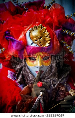 VENICE, ITALY - FEBRUARY 3, 2008: Unidentified person with Venetian carnival mask in Venice, Italy. At 2008 it is held from January 26th to February 5th. - stock photo