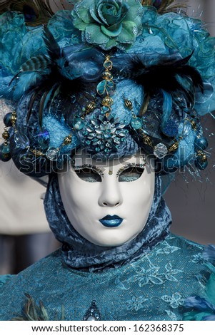 VENICE, ITALY - FEBRUARY 10: Unidentified person with Venetian carnival mask in Venice, Italy on February 10, 2013. At 2013 it is held from January 26th to February 12th.