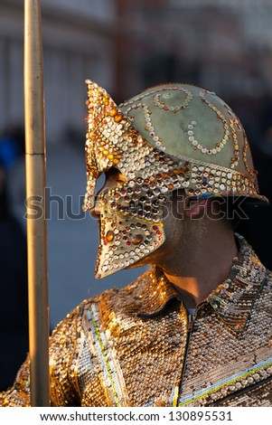 VENICE, ITALY - FEBRUARY 12: Unidentified persons in Venice mask at St. Mark's Square, Carnival of Venice on February 12, 2012. Annual carnival was held in 2012 from February 11 to February 21, 2012. - stock photo