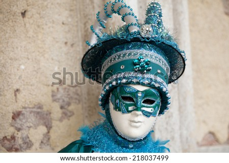 Venice, Italy - February 11 2012: Woman with typical venetian carnival costume at the Carnival of Venice. Shot in St. Mark's Square.  - stock photo