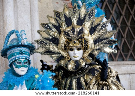 Venice, Italy - February 11 2012: Women with typical venetian carnival costume at the Carnival of Venice. Shot in St. Mark's Square..