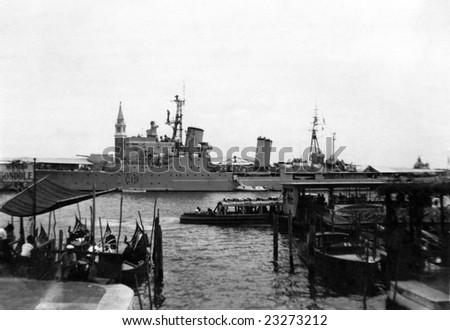 VENICE, ITALY - 1957 - HMS Birmingham C19 berthed in Venice in Italy - stock photo