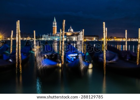 VENICE, ITALY - JANUARY 31, 2015: Gondolas in Venice and San Giorgio island