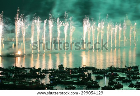 VENICE, ITALY - JULY 18:Fireworks over water during the celebrations of Redentore in Venice on july 18, 2015 in Venice, Italy. - stock photo