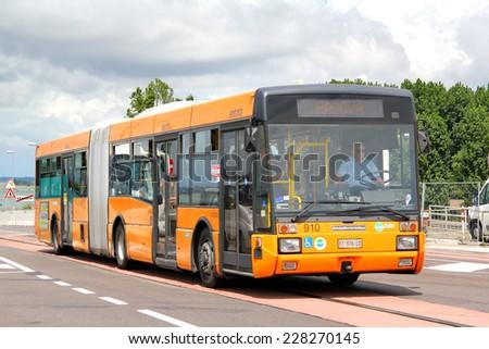 VENICE, ITALY - JULY 30, 2014: Orange articulated city bus Breda Menarini at the city street. - stock photo
