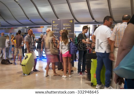 Venice, Italy - July 15, 2015: People in arrival hall of Marco Polo Airport  in motion blur on July 15, 2015, Venice, Italy.   - stock photo