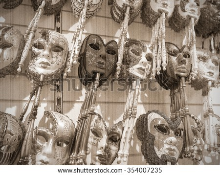 VENICE, ITALY - JUNE 26, 2014: Masks were worn in Venice to disguise the wearer from illicit activities: gambling, dancing, clandestine affairs or even political assignation. Old style. Sepia - stock photo