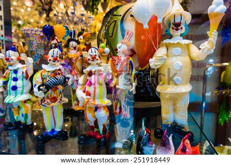 VENICE, ITALY - JUNE 1, 2014: Murano glass on display in window shop in market, Venice. Murano glass is a famous product of the Venetian island of Murano, traditional manufacturing centre. - stock photo