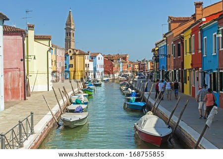 Venice, Italy, June 21, 2012 . Picturesque architecture of the island of Burano in the Venetian lagoon. The island attracts tourists unique coloring picturesque houses of local residents - stock photo