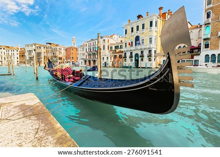 VENICE, ITALY - JUNE 26, 2014: The gondola is the most popular transport for the entertainment of tourists in Venice, Italy. - stock photo