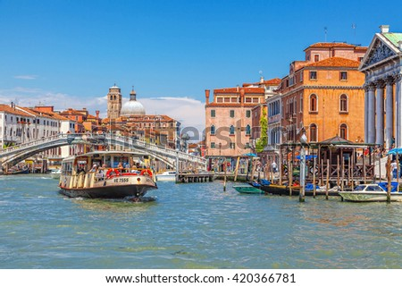 Venice, Italy - JUNE 05, 2013: Tourists make a walk on a boat at the Grand Canal. - stock photo