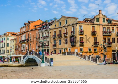 Venice, Italy - June 28, 2014: Tourists walking on a summer morning on the streets of Venice