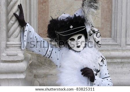 VENICE, ITALY  - MARCH 5: An unidentified person in Venetian costume attends the Carnival of Venice, annual festival starting around two weeks before Ash Wednesday and ends on Shrove Tuesday or Mardi Gras, on March 5, 2011 in Venice, Italy.