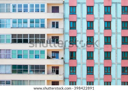 Venice, Italy - 29 March 2016:  Elevated view showing colourful side detail of windows and balconies of buildings near the street via Trento in Mestre, near Venice, Italy.  - stock photo