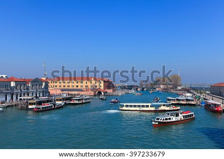 Venice, Italy - March 18, 2016: Grand canal of Venice with various canal traffic - Gondolas, Taxi-boats and Vaporettos (Water bus).