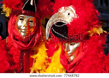 VENICE, ITALY - MARCH: Participant with a mask on in St. Mark's Square, Carnival of Venice on March 7, 2011 in Venice, Italy. The carnival was held from February 26 to March 8, 2011.