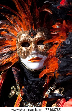 VENICE, ITALY - MARCH: Participant with a mask on in St. Mark's Square, Carnival of Venice on March 7, 2011 in Venice, Italy. The carnival was held from February 26 to March 8, 2011. - stock photo