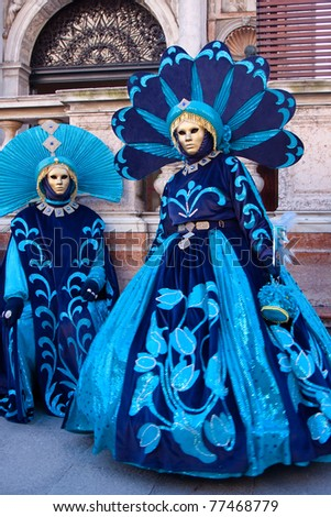 VENICE, ITALY - MARCH: Participants with a masks on in St. Mark's Square, Carnival of Venice on March 7, 2011 in Venice, Italy. The carnival was held from February 26 to March 8, 2011. - stock photo