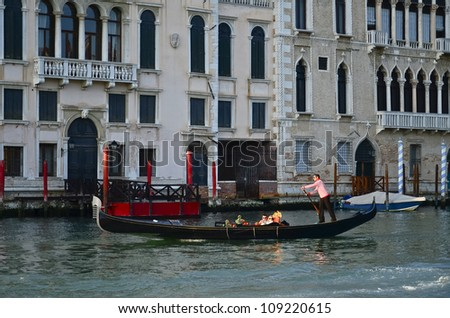 VENICE, ITALY - MARCH 28: Tourists on a Gondola, March 28, 2012 in Venice, Italy. The city has an average of 50,000 tourists a day and it's one of the world's most internationally visited city