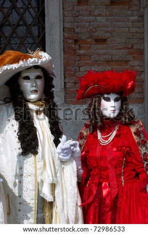 VENICE, ITALY - MARCH  5: Two unidentified masked individuals are seen at the Carnival of Venice on March 5, 2011 in Venice, Italy. It is an annual festival starting about 2 weeks before Ash Wednesday & ends on Shrove Tuesday/Mardi Gras.
