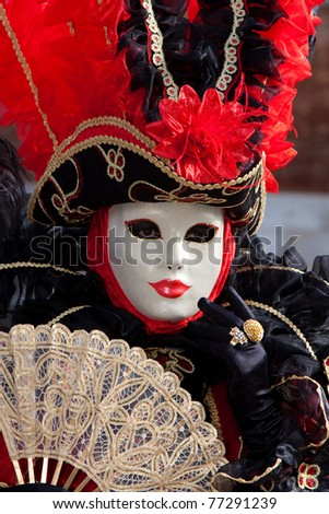VENICE, ITALY - MARCH 7: Venice mask at St. Mark's Square, Carnival of Venice on March 7, 2011. The carnival was held in 2011 from February 26 to March 8, 2011. - stock photo