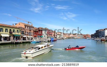 VENICE, ITALY - MAY 12, 2014: Ancient historical buildings and canal scene in Murano, Venice. - stock photo