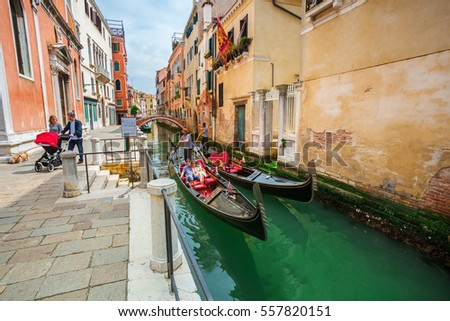 VENICE,ITALY-MAY 28, 2016: Beautiful view on canal with gondolas in romantic Venice,Italy