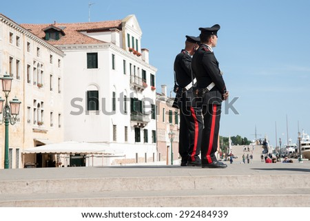 VENICE, ITALY-MAY 11: Carabinieri, from one of Italy's two uniformed  police forces provide travelers with security keeping a watch on activities as tourists pass by May 11, 2011 in Venice, Italy - stock photo