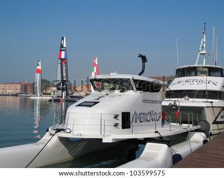 VENICE, ITALY - MAY 11: Luna Rossa AC45 (Piranha) in the team bases area waiting for a new test in the Venice lagoon during the America's Cup previous races days in May 11, 2012 in Venice, Italy. - stock photo