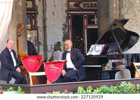 VENICE, ITALY - MAY 06, 2014: Musicians on the terrace under the canopy of the world famous Cafe Florian in Piazza San Marco in Venice, Italy