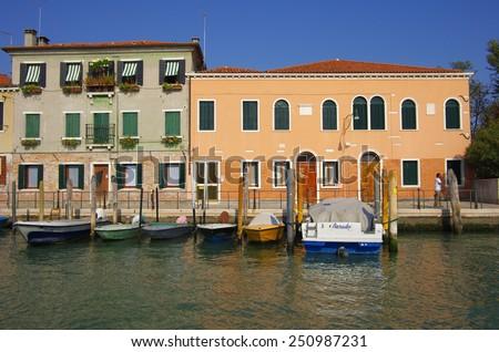 VENICE, Italy - OCTOBER 06: Quay of Murano island on October 06, 2011 Venice, Italy. One of beautiful medieval venetian canals on Murano island in Venetian Lagoon - stock photo