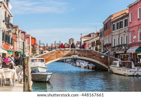 VENICE, ITALY - OCTOBER 17, 2015: The view of Murano lives beside the canal in Murano Island, Venice, Italy - stock photo