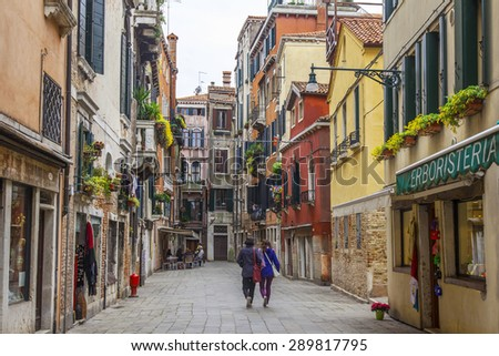 VENICE, ITALY - on APRIL 29, 2015. Pedestrians go on the narrow curve old street