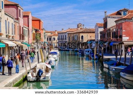 VENICE, ITALY, on March 29, 2015. Burano island, multi-colored houses of locals. Cafe on the bank of the channel. Burano the island