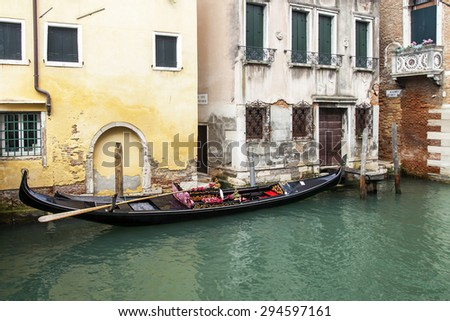 VENICE, ITALY - on MAY 3, 2015. City landscape early in the morning. The gondola is moored at the coast of the channel