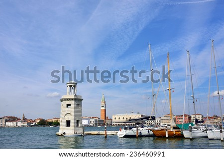 VENICE, ITALY - SEPT 24, 2014: View from San Giorgio Maggiore on San Marco square in Venice.Tourists from all the world enjoy the historical city of Venezia in Italy, famous UNESCO World Heritage Site
