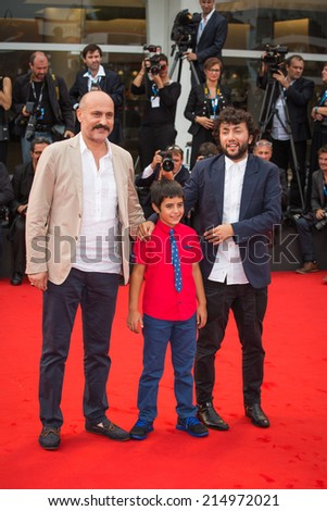 VENICE, ITALY - SEPTEMBER 03: Actors Muttalip Mujdeci, Dogan Izci and director Kaan Mujdeci attend the 'Sivas' Premiere during the 71st Venice Film Festival on September 3, 2014 in Venice, Italy.