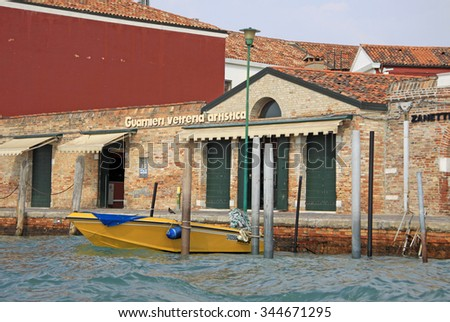 VENICE, ITALY - SEPTEMBER 04, 2012: An old glass factory on Murano island in the Venetian Lagoon  - stock photo
