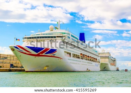 VENICE, ITALY, SEPTEMBER 20, 2015: Big cruise ship docked in the port of Venice. Journey on an ocean liner is one of the most attractive and user-friendly entertainment.