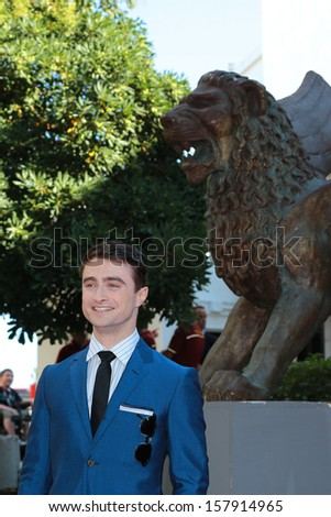 VENICE, ITALY - SEPTEMBER 01: Daniel Radcliffe arrives for film Kill Your Darlings of the register John Krokidas during the 70th Venice Film Festival on September 01, 2013 in Venice, Italy  - stock photo