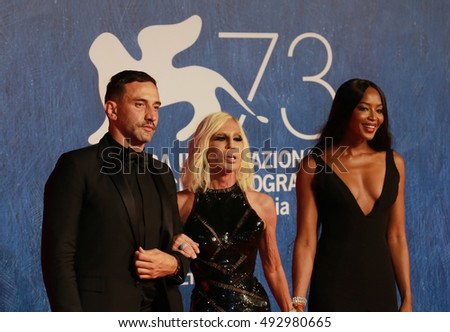 VENICE, ITALY - SEPTEMBER 02: Riccardo Tisci, Donatella Versace and Naomi Campbell during the 73th Venice Film Festival 2016 in Venice, Italy