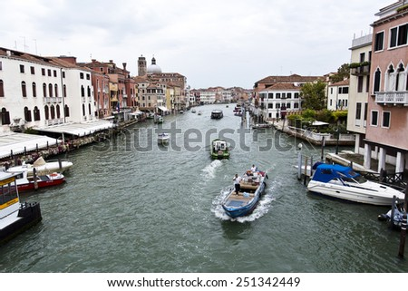 VENICE, ITALY SEPTEMBER 4, 2014: View of the Grand Canal and its intense boat traffic.  - stock photo