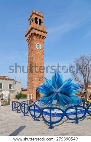 VENICE, ITALY - 14TH MARCH 2015: A view of the Bell and Clock Tower in Campo Santo Stefano in Murano. People can be seen in the square. - stock photo